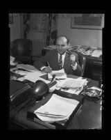 Pacific Colony mental hospital superintendant, Dr. George Tarjan, at his desk, 1950.