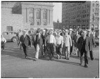 William F. Gettle's kidnappers leave the L.A. County courthouse after being charged with the crime of extortion through the mails.  May 28, 1934.