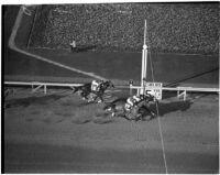 Horses race on Derby Day at Santa Anita, February 22, 1937.