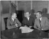 Photograph of Charles P. Schottland, Roy W. Pilling, and Archibald Young,  administrators of Los Angeles' and California's state relief organizations during the Great Depression.