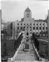 View of the entrance and lawn of the Los Angeles Public (Central) Library, downtown Los Angeles.  Circa 1936.