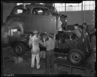 Men at work at the Los Angeles Studebaker assembly plant in Vernon, CA.  Circa January 2, 1936.