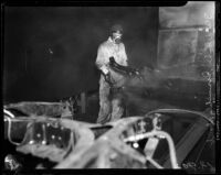 Man at work at the Los Angeles Studebaker assembly plant in Vernon, CA.  Circa January 2, 1936.