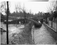 Damage after near-tornado level winds and rain strike Alhambra and neighboring communities.  February 13, 1936.