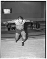Wrestler and football player Bronko Nagurski in the ring before his match against Vincent López at Wrigley Field, Los Angeles, 1937