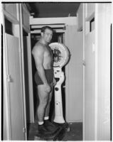 Wrestler and football player Bronko Nagurski on the scale before a wrestling match at Wrigley Field, Los Angeles, August 11, 1937