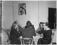 Female impersonator Johnnie David and five others seated at a table smoking and drinking, Hollywood, circa 1937