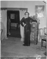 Female impersonator Johnnie David poses in an evening gown, Hollywood, circa 1937