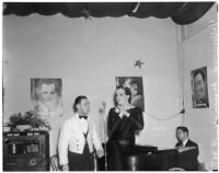 Female impersonator Johnnie David preparing to sing with an unidentified man, Hollywood, circa 1937