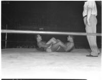 Wrestlers Martinez and Sanandos in a leg lock during their match, Los Angeles