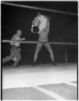 Wrestler Dean Detton about to slam his opponent Kiman Kudo into the mat at Olympic Auditorium, Los Angeles, August 25, 1937