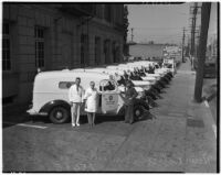 Doctors and policemen pose with the new police ambulance, Los Angeles, circa 1940