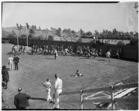 UCLA football players running at Spaulding Field on opening day of the season, Los Angeles, September 1937