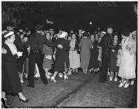 Police regulate the crowd at a movie premiere, Los Angeles