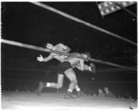 Gino Garibaldi tackles La Verne Baxter during a wrestling match at Olympic Auditorium, Los Angeles, September 22, 1937