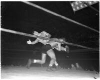 Gino Garibaldi tackles La Verne Baxter during a wrestling match at Olympic Auditorium, Los Angeles, September 22, 1937