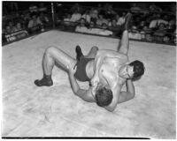 Heavyweight wrestler Vincent López puts his opponent in a headlock, Los Angeles, 1930s