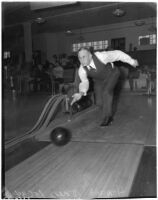 Howard Jones, USC football coach from 1925-1940, bowling, Los Angeles, circa 1940