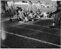 Players on the ground during a Polytechnic vs. L.A. High School football game, Los Angeles, September 30, 1937