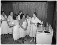 Women listening to an instructor at the School for Household Employees, Los Angeles