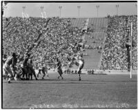USC Trojans punt during a football game against the Ohio State Buckeyes at the Coliseum, Los Angeles, October 9, 1937