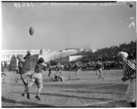 Players battle for the ball during a football game between Franklin and Roosevelt High Schools, Los Angeles, October 8, 1937