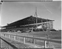 Construction on the grandstand at Santa Anita Park which would enlarge the capacity by 3000 to 5000 seats, Arcadia, 1930s