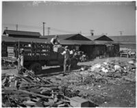 Members of the Unemployed Citizens' League of Santa Monica work together to load a pickup truck, Santa Monica, 1930s