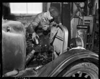 Man works on a tractor engine at the Unemployed Citizens' League of Santa Monica, 1930s