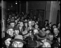Robert Noble's supporters waiting to greet him at the courthouse when he arrives to face misdemeanor charges, Los Angeles, November 3, 1937