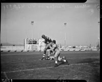 Western League championship football game between Fairfax and L.A. High Schools at Gilmore Stadium, Los Angeles, November 5, 1937