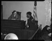 Coroner Frank Nance listens to a testimony from Leona Navy at the Paul A. Wright inquest, Los Angeles, November 12, 1937