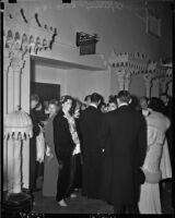 Crowd waiting to enter Shrine Auditorium for a performance of Tristan and Isolde on opening night of the opera, Los Angeles, November 15, 1937