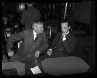 Paul A. Wright and his father J.J. Wright at the trial where Paul A. Wright is charged with the double murder of his wife and best friend, Los Angeles, November, 1937