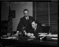 "District Attorney Buron Fitts and John Klein, announcing the creation of a ""gang squad"" designed to rid Los Angeles of gangsters and racketeers, Los Angeles, November 17, 1937"