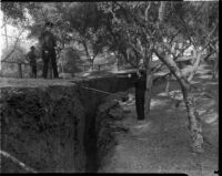 Officials survey a crack that would become a landslide in Elysian Park, Los Angeles, November 1937