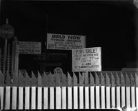 Signs on Riverside Drive which was affected by a landslide in Elysian Park, Los Angeles, November 1937