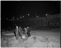 Men working at night to repair damage from the Elysian Park landslide, Los Angeles, November 1937