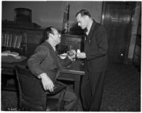 Attorney A. Brigham Rose and grand jury member Clifford E. Clinton facing charges of contempt, Los Angeles, December 1937