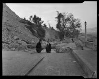 Two men stand near a crack that widened into a landslide in Elysian Park, Los Angeles, November 1937