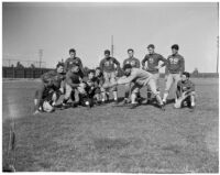 Members of the Loyola University football team with their coach, Los Angeles, 1930s