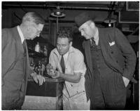 Coroner Frank Nance, chemist Miles Drake, and Det. Lt. Aldo Corsini examining something in a chemistry lab, Los Angeles, 1930s
