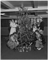 Matron Vada Sullivan Russell and others decorate a Christmas tree at the Los Angeles County Jail, 1930s