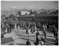 Alabama Crimson Tide football team arriving at the Pasadena train station for 1938 Rose Bowl Game, December 24, 1937