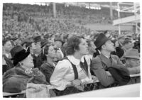 Spectators watch a race on opening day of Santa Anita's fourth horse racing season, Arcadia, December 25, 1937