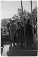 Spectators between races on opening day of Santa Anita's fourth horse racing season, Arcadia, December 25, 1937