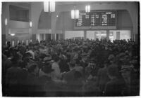 Spectators place their bets on opening day of Santa Anita's fourth horse racing season, Arcadia, December 25, 1937