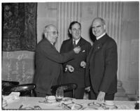 Louis B. Mayer, Rabbi Edgar F. Magnin, and Bishop Bertrand Stevens at the Biltmore Hotel for a meeting concerning fund raising for the National Foundation for Infantile Paralysis, Los Angeles, December 12, 1938