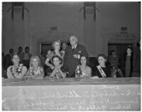 Governor Frank Finley Merriam and Adele Arbo stand behind five young beauty contestants, Los Angeles, 1930s