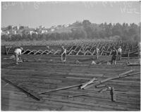 Construction workers on the Ivanhoe Reservoir near Silver Lake, Los Angeles